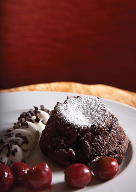 molten-lava-cake-with-cherry-compote-and-cream